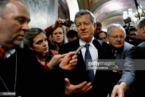 Senate Finance Committee Chairman Max Baucus is surrounded by reporters after leaving a meeting with fellow members of the Joint Select Committee on...