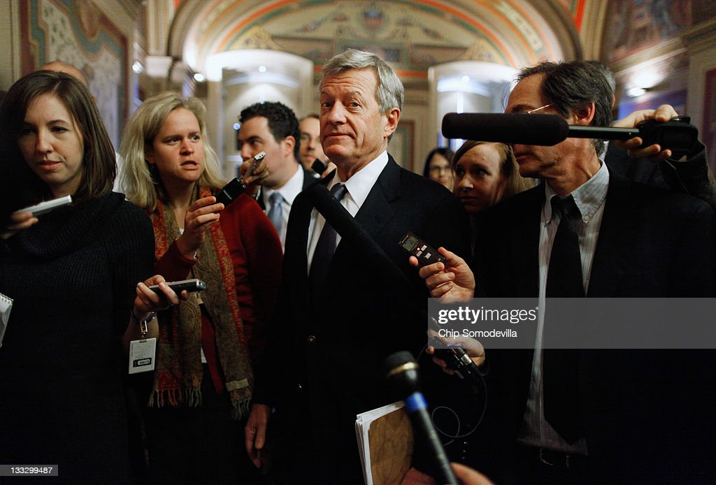 Senate Finance Committee Chairman <a gi-track='captionPersonalityLinkClicked' href=/galleries/search?phrase=Max+Baucus&family=editorial&specificpeople=242972 ng-click='$event.stopPropagation()'>Max Baucus</a> (D-MT) (C) is surrounded by reporters after leaving a meeting with fellow members of the Joint Select Committee on Deficit Reduction, or 'Supercommittee,' in the U.S. Capitol November 18, 2011 in Washington, DC. With the deadline just five days away, members of the supercommittee are meeting in a frantic effort to reach a deal.