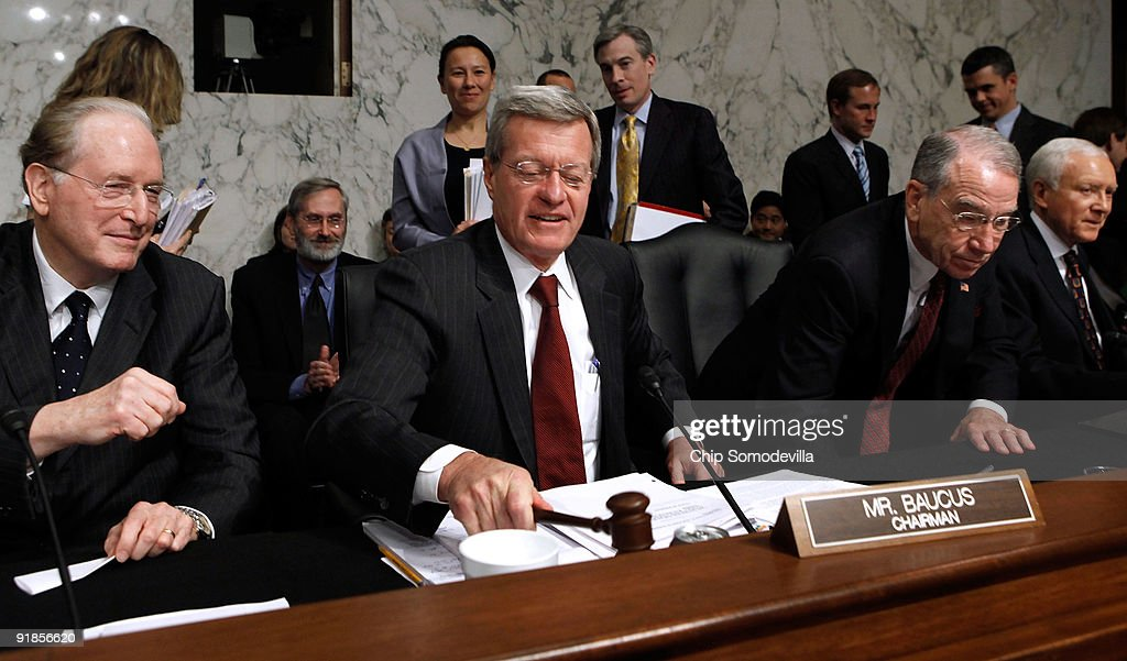 Senate Finance Committee Chairman <a gi-track='captionPersonalityLinkClicked' href=/galleries/search?phrase=Max+Baucus&family=editorial&specificpeople=242972 ng-click='$event.stopPropagation()'>Max Baucus</a> (D-MT) (C) lowers the gavel after the committee voted 14-9 to pass health care reform legislation with Sen. John Rockefeller (D-WV) (L), ranking member Sen. Charles Grassley (R-IA) and Sen. Orrin Hatch (R-UT) (R) on Capitol Hill October 13, 2009 in Washington, DC. Sen. Olympia Snowe (R-ME) casted the only Republican vote for the groundbreaking legislation.