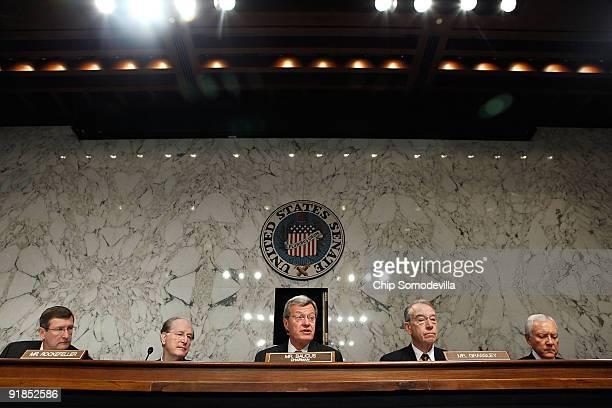 Senate Finance Committee Chairman Max Baucus makes an opening statement as committee members Sen Kent Conrad Sen John Rockefeller ranking member Sen...