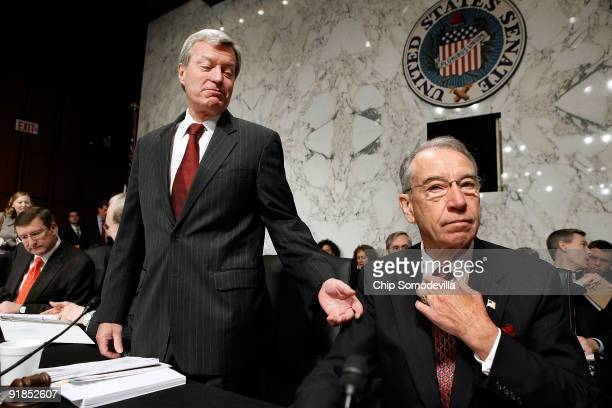 Senate Finance Committee Chairman Max Baucus talks with ranking member Sen Charles Grassley before the committee is set to vote on health care reform...