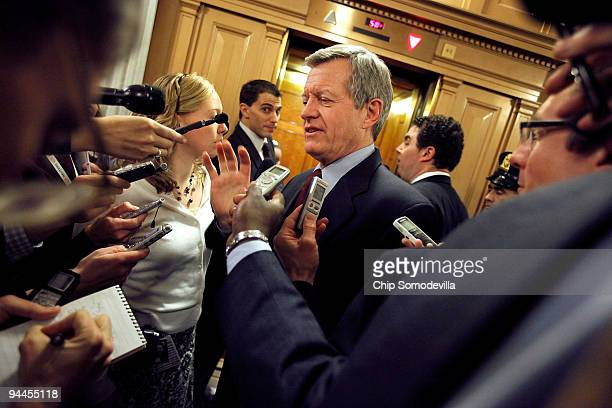Senate Finance Committee Chairman Max Baucus talks with reporters after a Senate Democratic caucus meeting at the US Capitol December 14 2009 in...