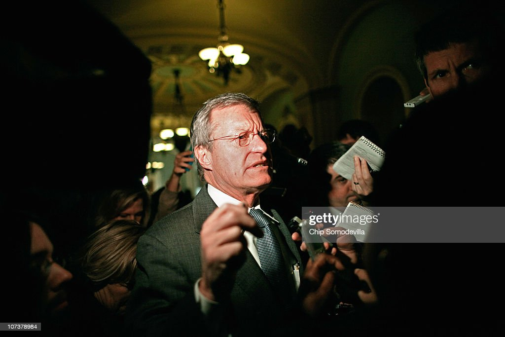 Senate Finance Committee Chairman Sen. <a gi-track='captionPersonalityLinkClicked' href=/galleries/search?phrase=Max+Baucus&family=editorial&specificpeople=242972 ng-click='$event.stopPropagation()'>Max Baucus</a> (D-MT) (C) arrives for the Senate Democratic Caucus luncheon in the U.S. Capitol December 7, 2010 in Washington, DC. Vice President Joe Biden joined the caucus luncheon to talk about the deal struck between Republicans and the White House to extend the Bush-era tax cuts to the middle class and those making more than $250,000 a year.