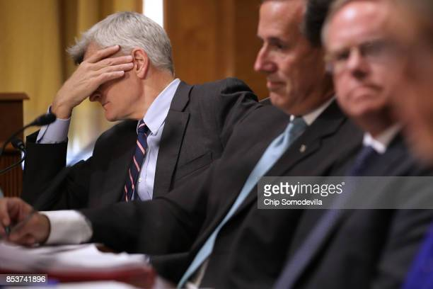 Senate Finance Committee member Sen Bill Cassidy listens to fellow pannelists and witnesses during a hearing about the proposed GrahamCassidy...