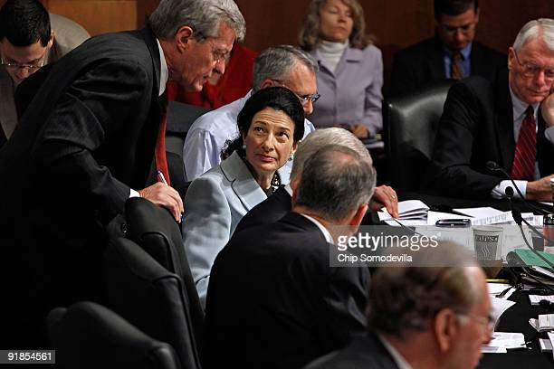 Senate Finance Committee member Sen Olympia Snowe talks with committee Chairman Max Baucus moments before she announced her support for the health...