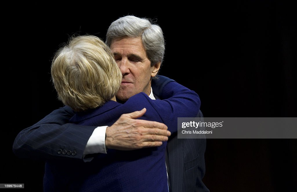 Senate Foreign Relations Chairman Sen. John Kerry, D-Mass., President Barack Obama's nominee to become secretary of state, hugs Sen. Elizabeth Warren, D-Mass., at his confirmation hearing before the Senate Foreign Relations committee to replace Hillary Rodham Clinton.