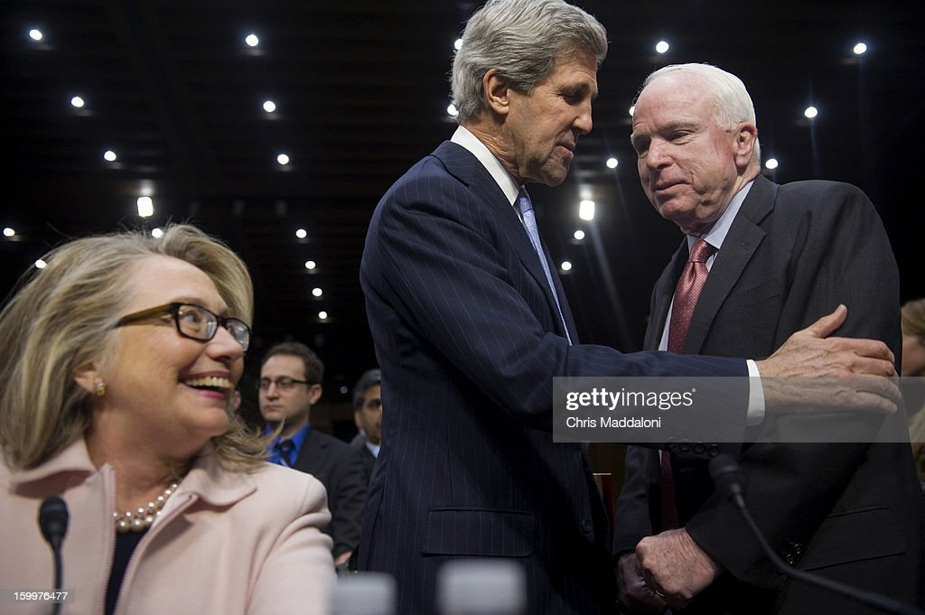 Senate Foreign Relations Chairman Sen. John Kerry, D-Mass., President Barack Obama's nominee to become secretary of state, jokes with Sen. John McCain, R-Ariz., and Secretary of State Hillary Clinton at his confirmation hearing before the Senate Foreign Relations committee. Kerry, if confirmed, would replace Clinton as Secretary.