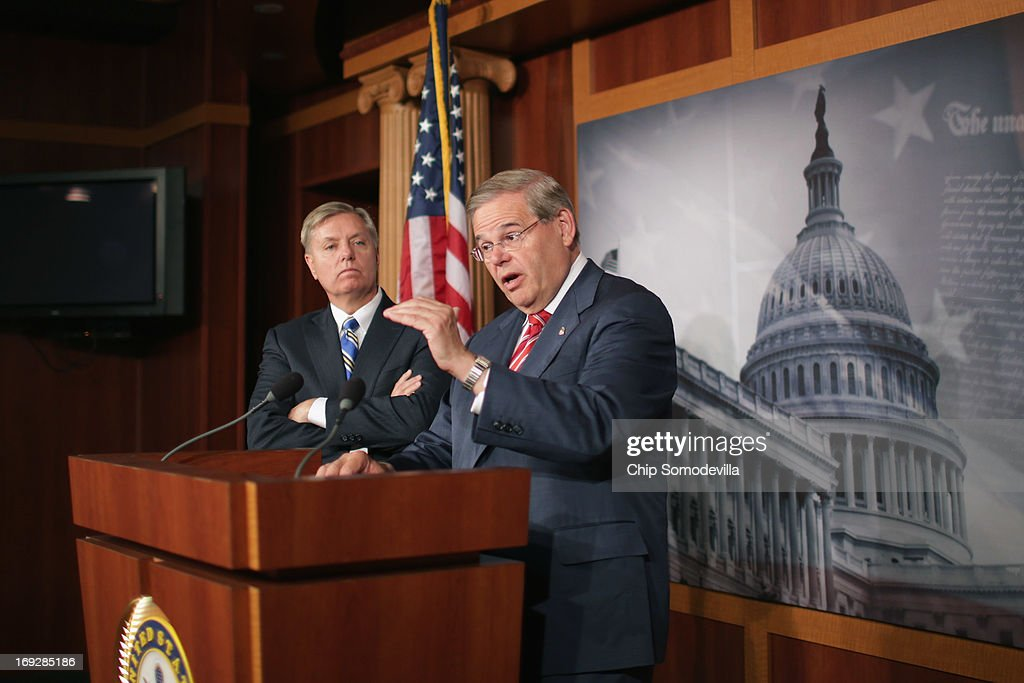 U.S. Senate Foreign Relations Committee Chairman <a gi-track='captionPersonalityLinkClicked' href=/galleries/search?phrase=Robert+Menendez&family=editorial&specificpeople=504931 ng-click='$event.stopPropagation()'>Robert Menendez</a> (D-NJ) (R) and U.S. Sen. <a gi-track='captionPersonalityLinkClicked' href=/galleries/search?phrase=Lindsey+Graham&family=editorial&specificpeople=240214 ng-click='$event.stopPropagation()'>Lindsey Graham</a> (R-SC) hold a news conference after the senate voted 99-0 in favor of their resolution in support of Israel May 22, 2013 in Washington, DC. The resolution 'expresses concerns about the Iranian nuclear threat and urges that if Israel is compelled to take action in self-defense, the United States will stand with Israel and provide diplomatic, military, and economic support in its defense of its territory, people, and existence.'