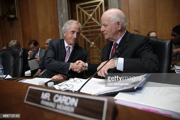 Senate Foreign Relations Committee Chairman Sen Bob Corker shakes hands with ranking member Sen Ben Cardin during a committee markup meeting April 14...