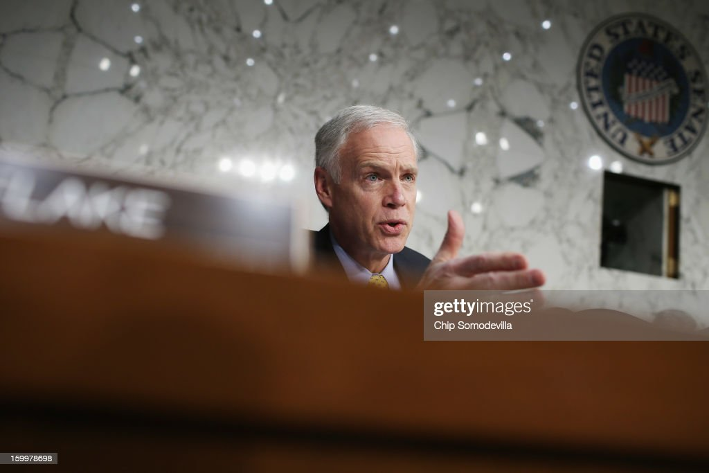 Senate Foreign Relations Committee member Sen. Ron Johnson (R-WI) questions Sen. John Kerry (D-MA) during his confirmation hearing to become the next Secretary of State in the Hart Senate Office Building on Capitol Hill January 24, 2013 in Washington, DC. Nominated by President Barack Obama to succeed Hillary Clinton as Secretary of State, Kerry has served on this committee for 28 years and has been chairman for four of those years.