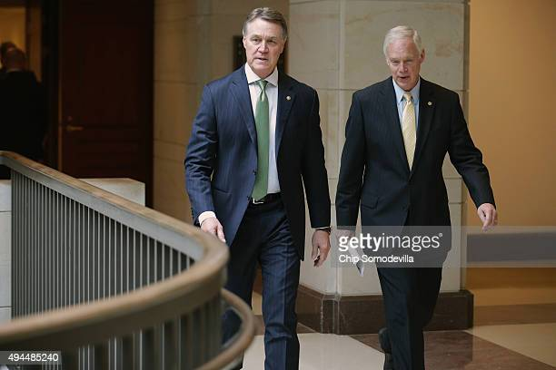 Senate Foreign Relations Committee members Sen David Perdue and Sen Ron Johnson take a quick break from a closeddoor heaing with US Secretary of...