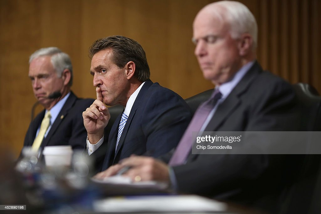Senate Foreign Relations Committee members (L-R) Sen. Ron Johnson (R-WI), Sen. Jeff Flake (R-AZ) and Sen. John McCain (R-AZ) hear testimony from State and Treasury departments officials during a hearing about the ongoing P-5+1 talks with Iran in the Dirksen Senate Office Building on Capitol Hill July 29, 2014 in Washington, DC. Many members of the committee are skeptical that the Obama Administration's agreement to extended talks with Iran for an additional four months will apply enough pressure to force an agreement.