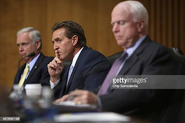 Senate Foreign Relations Committee members Sen Ron Johnson Sen Jeff Flake and Sen John McCain hear testimony from State and Treasury departments...
