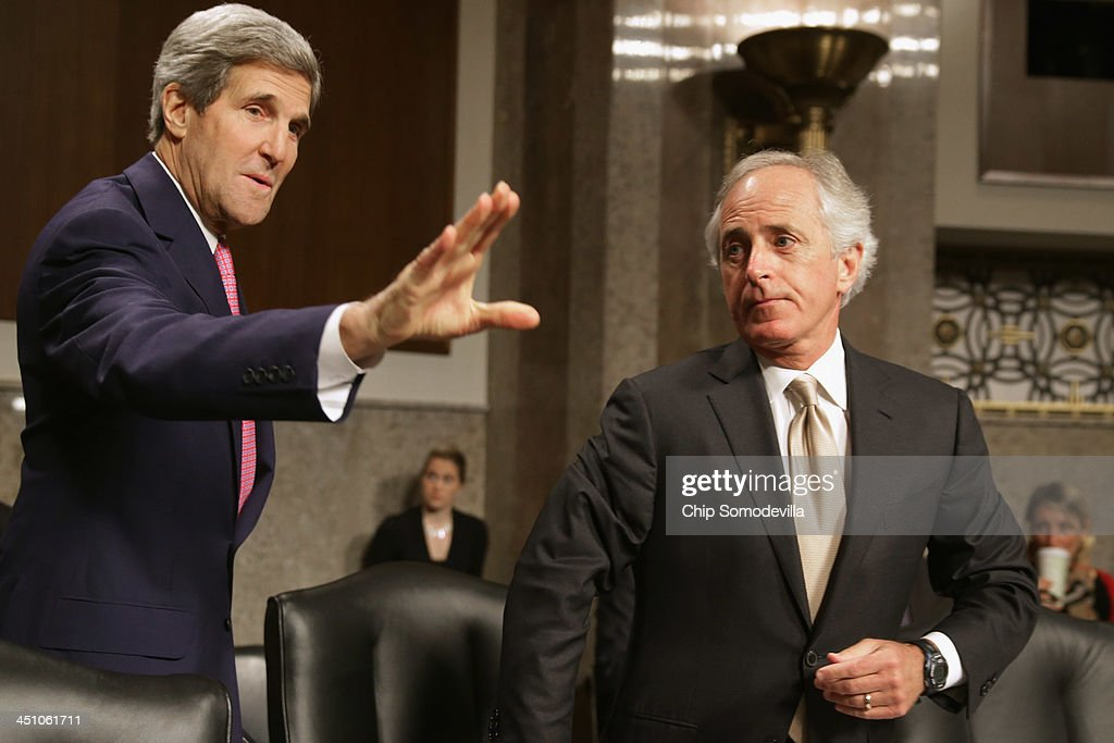 Senate Foreign Relations Committee ranking member Sen. <a gi-track='captionPersonalityLinkClicked' href=/galleries/search?phrase=Bob+Corker&family=editorial&specificpeople=3986296 ng-click='$event.stopPropagation()'>Bob Corker</a> (R-TN) (R) looks on as U.S. Secretary of State <a gi-track='captionPersonalityLinkClicked' href=/galleries/search?phrase=John+Kerry&family=editorial&specificpeople=154885 ng-click='$event.stopPropagation()'>John Kerry</a> prepares to testify to the committee about the Convention on the Rights of Persons with Disabilities in the Dirksen Senate Office Building on Capitol Hill November 21, 2013 in Washington, DC. Kerry encouraged the committee to vote for adoption of the treaty which he says will bring standards enjoyed by handicapped and disabled people in the United States to the international community.