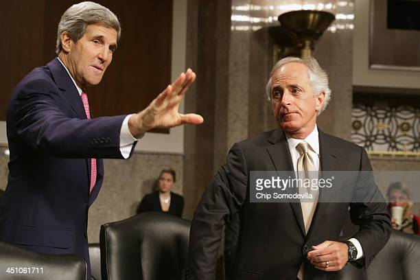 Senate Foreign Relations Committee ranking member Sen Bob Corker looks on as US Secretary of State John Kerry prepares to testify to the committee...