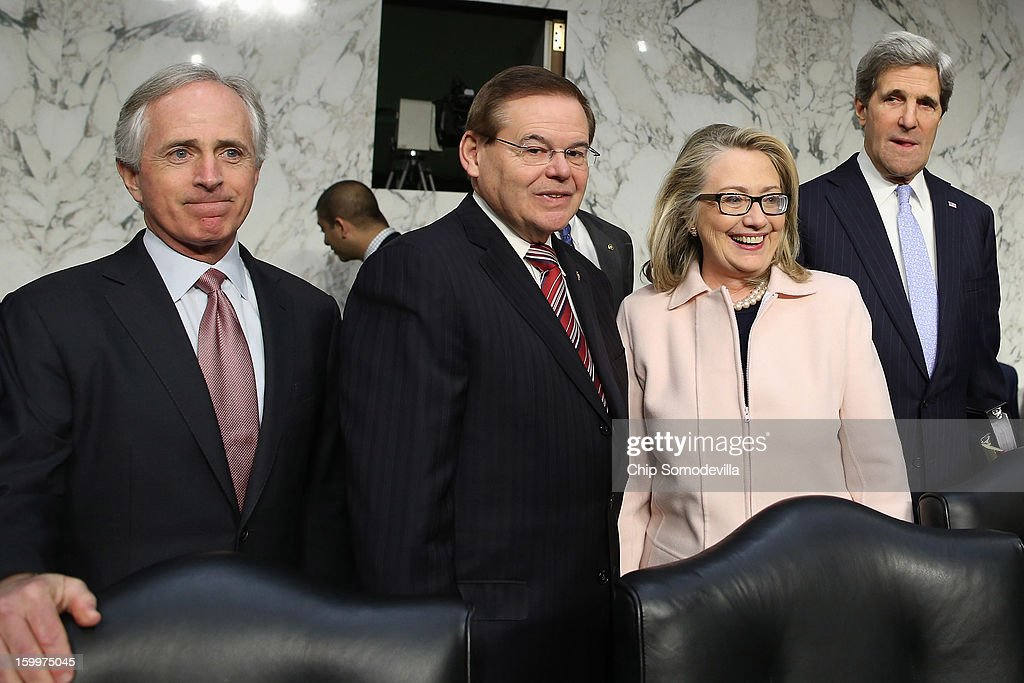Senate Foreign Relations Committee ranking member Sen. Bob Corker (R-TN), Chairman Sen. Robert Menendez (D-NJ), U.S. Secretary of State Hillary Clinton and Sen. John Kerry (D-MA) arrive for Kerry's confirmation hearing to become the next Secretary of State in the Hart Senate Office Building on Capitol Hill January 24, 2013 in Washington, DC. Nominated by President Barack Obama to succeed Hillary Clinton as Secretary of State, Kerry has served on this committee for 28 years and has been chairman for four of those years.