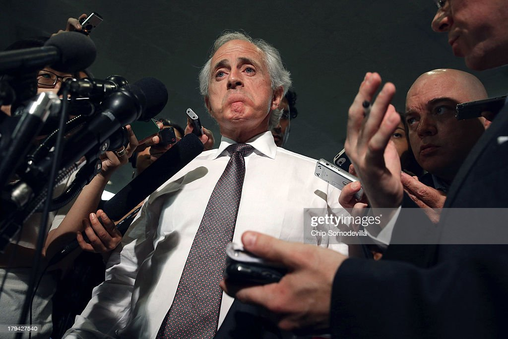 Senate Foreign Relations Committee ranking member Sen. <a gi-track='captionPersonalityLinkClicked' href=/galleries/search?phrase=Bob+Corker&family=editorial&specificpeople=3986296 ng-click='$event.stopPropagation()'>Bob Corker</a> (R-TN) (C) talks to reporters before heading into a members-only classified briefing about Syria at the U.S. Capitol September 3, 2013 in Washington, DC. The Foreign Relations Committee will hear testimony today from Secretary of State John Kerry, Secretary of Defense Chuck Hagel and Chairman of the Joint Chiefs of Staff Gen. Martin Dempsey.