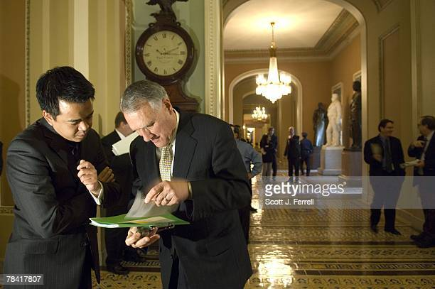 Senate GOP Conference Chairman Jon Kyl RAriz with an aide in the Ohio Clock Corridor after a news conference on the omnibus appropriations bill House...