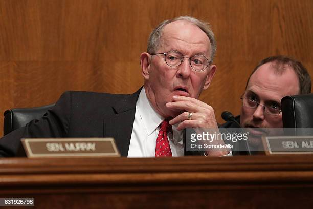Senate Health Education Labor and Pensions Committee Chairman Lamar Alexander listens to testimony from Betsy DeVos Presidentelect Donald Trump's...