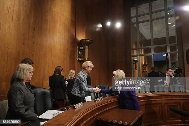 Senate Health Education Labor and Pensions Committee member Sen Tammy Baldwin shakes hands with Betsy DeVos Presidentelect Donald Trump's pick to be...