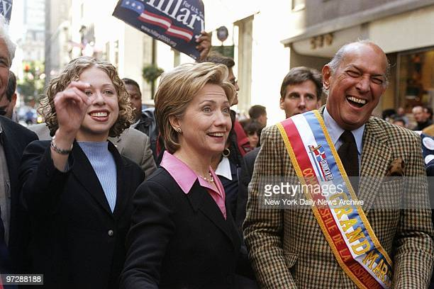 Senate hopeful Hillary Rodham Clinton is flanked by her daughter Chelsea and Grand Marshal Oscar de la Renta as they walk up Fifth Ave in the 35th...