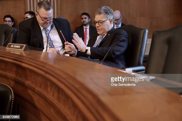Senate Indian Affairs Committee members Sen Jon Tester and Sen Al Franken talk before a hearing in the Dirksen Senate Office Building on Capitol Hill...