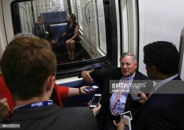 Senate Intelligence Committee Chairman Richard Burr speaks to reporters while riding the Senate Subway before attending a closed door committee...