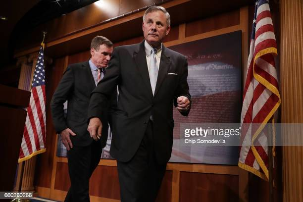 Senate Intelligence Committee ranking member Sen Mark Warner and Chairman Richard Burr leave a news conference about the committee's investigation...