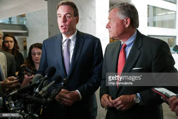 Senate Intelligence Committee ranking member Sen Mark Warner and Chairman Richard Burr talk to reporters after meeting behind closed doors with...