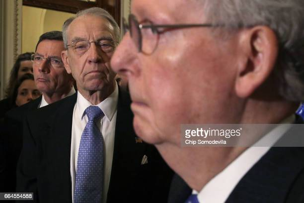Senate Judiciary Committee Chairman Charles Grassley joins Sen John Barrasso and Majority Leader Mitch McConnell for a news conference following the...
