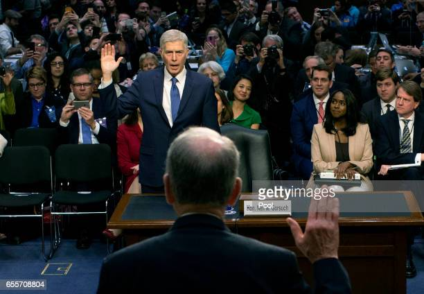 Senate Judiciary Committee Chairman Charles Grassley swears in Judge Neil Gorsuch during the first day of his Supreme Court confirmation hearing...