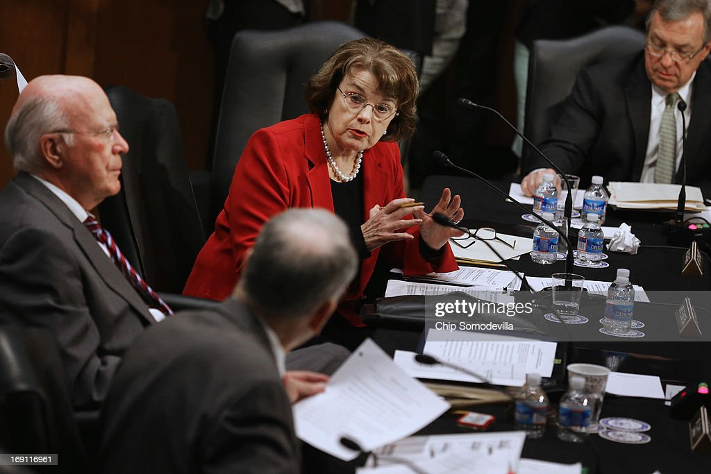 Senate Judiciary Committee Chairman Patrick Leahy (D-VT), Sen. Charles Grassley (R-IA) (back to camera), Sen. <a gi-track='captionPersonalityLinkClicked' href=/galleries/search?phrase=Dianne+Feinstein&family=editorial&specificpeople=214078 ng-click='$event.stopPropagation()'>Dianne Feinstein</a> (D-CA) and Sen. Richard Durbin (D-IL) debate during a markup session for the immigration reform legislation now before the committee in the Hart Senate Office Building on Capitol Hill May 20, 2013 in Washington, DC. The Judiciary Committee is hoping to wrap up work on the landmark immigration reform bill this week after wading through the 300 amendments that were filed to the bipartisan bill.