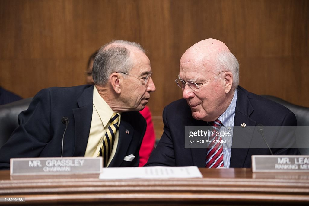 US Senate Judiciary Committee chairman Senator Chuck Grassley (L) of Iowa and Ranking Member Senator Patrick Leahy of Vermont chat before a hearing on Oversight of the Department of Homeland Security on Capitol Hill in Washington, DC, on June 30, 2016. / AFP / Nicholas Kamm