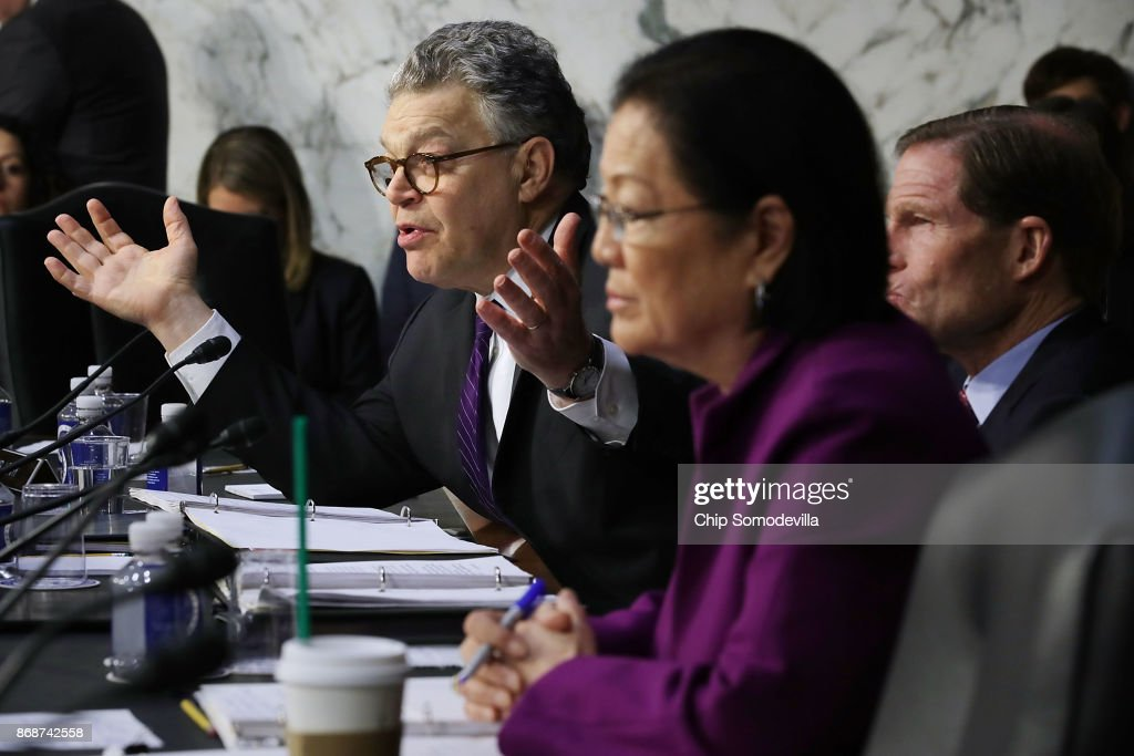 Senate Judiciary Committee member Sen. Al Franken (D-MN) (L) questions witnesses from Google, Facebook and Twitter during a Crime and Terrorism Subcommittee hearing in the Hart Senate Office Building on Capitol Hill October 31, 2017 in Washington, DC. The committee questioned the tech company representatives about attempts by Russian operatives to spread disinformation and purchase political ads on their platforms, and what efforts the companies plan to use to prevent similar incidents in future elections.