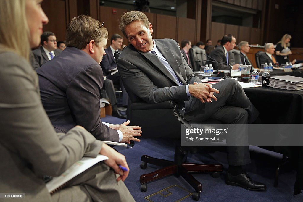 Senate Judiciary Committee member Sen. <a gi-track='captionPersonalityLinkClicked' href=/galleries/search?phrase=Jeff+Flake&family=editorial&specificpeople=2474871 ng-click='$event.stopPropagation()'>Jeff Flake</a> (R-AZ) talks with members of his staff during a markup session for the immigration reform legislation in the Hart Senate Office Building on Capitol Hill May 20, 2013 in Washington, DC. The Judiciary Committee is hoping to wrap up work on the landmark immigration reform bill this week after wading through the 300 amendments that were filed to the bipartisan bill.
