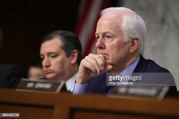 Senate Judicary Committee member Sen John Cornyn listens to witnesses during a subcommittee hearing on Russian interference in the 2016 election in...