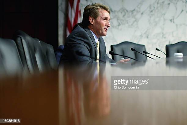 Senate Judiciary Committee member Sen Sen Jeff Flake questions witnesses during hearing about gun control on Capitol Hill January 30 2013 in...