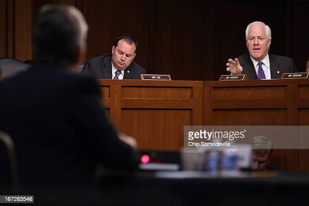 Senate Judicary Committee members Sen John Cornyn and Sen Mike Lee question Homeland Security Secretary Janet Napolitano during a hearing on Capitol...