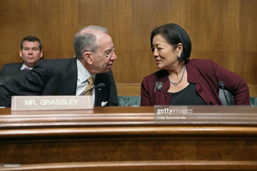 Senate Judiciary Committee ranking member Sen. Charles Grassley (R-IA) (L) and Sen. Mazie Hirono (D-HI) visit before the start of a full committee hearing March 18, 2013 in Washington, DC. The committee heard testimony about immigration reform in regards to women and families during the hearing, titled 'How Comprehensive Immigration Reform Should Address the Needs of Women and Families.'