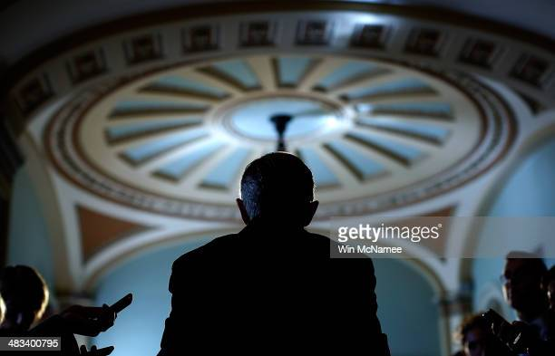 Senate Majorirty Leader Harry Reid speaks with reporters following the weekly policy luncheon for Senate Democrats April 8 2014 in Washington DC...