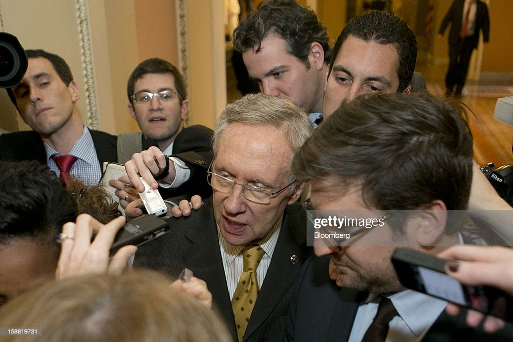 Senate Majority Leader <a gi-track='captionPersonalityLinkClicked' href=/galleries/search?phrase=Harry+Reid+-+Pol%C3%ADtico&family=editorial&specificpeople=203136 ng-click='$event.stopPropagation()'>Harry Reid</a>, a Democrat from Nevada, center, speaks to members of the media following a caucus meeting at the U.S. Capitol in Washington, D.C., U.S., on Sunday, Dec. 30, 2012. Senator Reid rejected the latest Republican offer to resolve the U.S. fiscal crisis as Minority Leader Mitch McConnell reached out to Vice President Joe Biden in an effort to break the impasse. Photographer: Andrew Harrer/Bloomberg via Getty Images