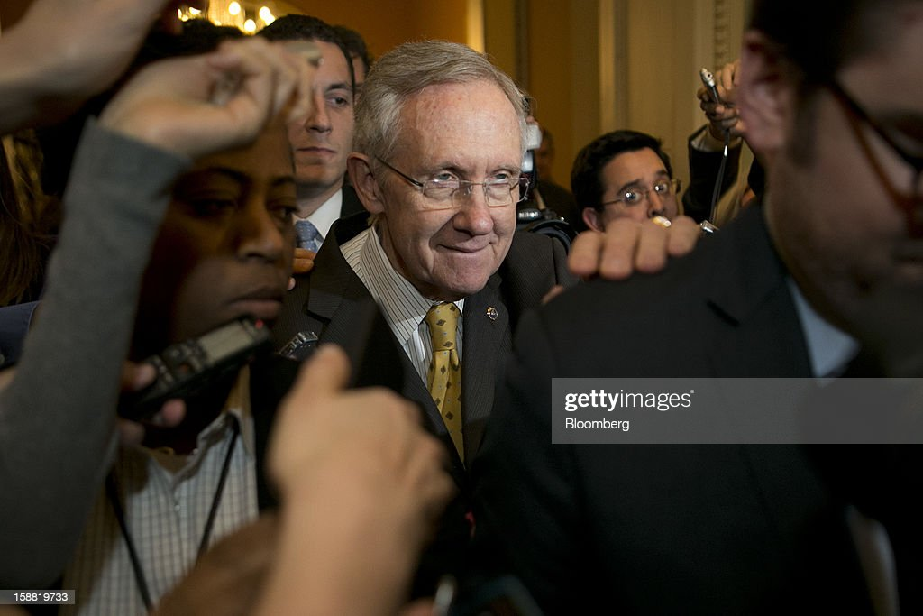 Senate Majority Leader <a gi-track='captionPersonalityLinkClicked' href=/galleries/search?phrase=Harry+Reid+-+Politico&family=editorial&specificpeople=203136 ng-click='$event.stopPropagation()'>Harry Reid</a>, a Democrat from Nevada, center, walks out of a caucus meeting at the U.S. Capitol in Washington, D.C., U.S., on Sunday, Dec. 30, 2012. Senator Reid rejected the latest Republican offer to resolve the U.S. fiscal crisis as Minority Leader Mitch McConnell reached out to Vice President Joe Biden in an effort to break the impasse. Photographer: Andrew Harrer/Bloomberg via Getty Images