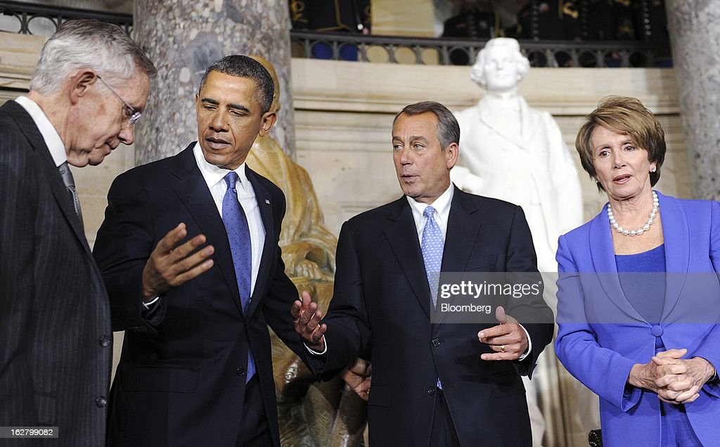 """Senate Majority Leader Harry Reid, a Democrat from Nevada, from left, U.S. President Barack Obama, House Speaker John Boehner, a republican from Ohio, and House Minority Leader Nancy Pelosi, a Democrat from California, chat during the unveiling of a statue of civil rights icon Rosa Parks at the Capitol in Washington, D.C., U.S., on Wednesday, Feb. 27, 2013. 'With the simplest of gestures, she helped change America and change the world,"""" Obama said at the ceremony. Photographer: Olivier Douliery/Pool via Bloomberg"""
