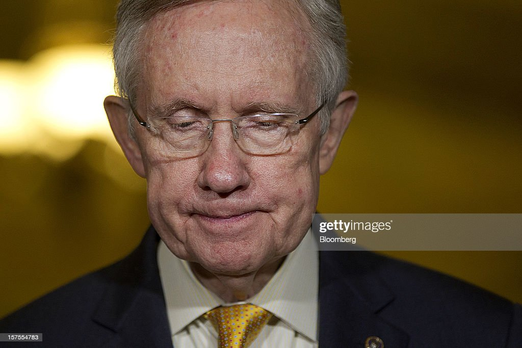 Senate Majority Leader <a gi-track='captionPersonalityLinkClicked' href=/galleries/search?phrase=Harry+Reid+-+Politician&family=editorial&specificpeople=203136 ng-click='$event.stopPropagation()'>Harry Reid</a>, a Democrat from Nevada, pauses while speaking during a news conference after the weekly Senate Democratic Policy Committee meeting at the U.S. Capitol in Washington, D.C., U.S., on Tuesday, Dec. 4, 2012. Negotiations over the so-called fiscal cliff are stalled as President Obama and Republicans trade offers on ways to avoid more than $600 billion in U.S. spending cuts and tax increases for 2013 that will start to take effect in January if Congress doesn't act. Photographer: Andrew Harrer/Bloomberg via Getty Images