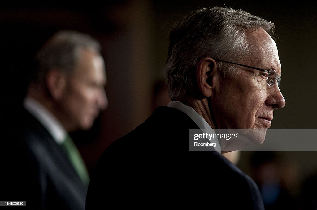 Senate Majority Leader <a gi-track='captionPersonalityLinkClicked' href=/galleries/search?phrase=Harry+Reid+-+Politician&family=editorial&specificpeople=203136 ng-click='$event.stopPropagation()'>Harry Reid</a>, a Democrat from Nevada, right, and Senator <a gi-track='captionPersonalityLinkClicked' href=/galleries/search?phrase=Charles+Schumer&family=editorial&specificpeople=171249 ng-click='$event.stopPropagation()'>Charles Schumer</a>, a Democrat from New York, attend a news conference at the U.S. Capitol in Washington, D.C., U.S., on Wednesday, Oct. 16, 2013. The Senate voted 81-18 to halt the 16-day government shutdown and raise the U.S. debt limit, moving one step closer to ending the nation's fiscal impasse. Photographer: Pete Marovich/Bloomberg via Getty Images