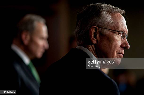Senate Majority Leader Harry Reid a Democrat from Nevada right and Senator Charles Schumer a Democrat from New York attend a news conference at the...