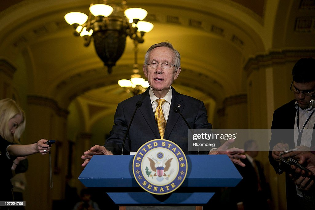 Senate Majority Leader <a gi-track='captionPersonalityLinkClicked' href=/galleries/search?phrase=Harry+Reid+-+Politician&family=editorial&specificpeople=203136 ng-click='$event.stopPropagation()'>Harry Reid</a>, a Democrat from Nevada, speaks during a news conference after the weekly Senate Democratic Policy Committee meeting at the U.S. Capitol in Washington, D.C., U.S., on Tuesday, Dec. 4, 2012. Negotiations over the so-called fiscal cliff are stalled as President Obama and Republicans trade offers on ways to avoid more than $600 billion in U.S. spending cuts and tax increases for 2013 that will start to take effect in January if Congress doesn't act. Photographer: Andrew Harrer/Bloomberg via Getty Images
