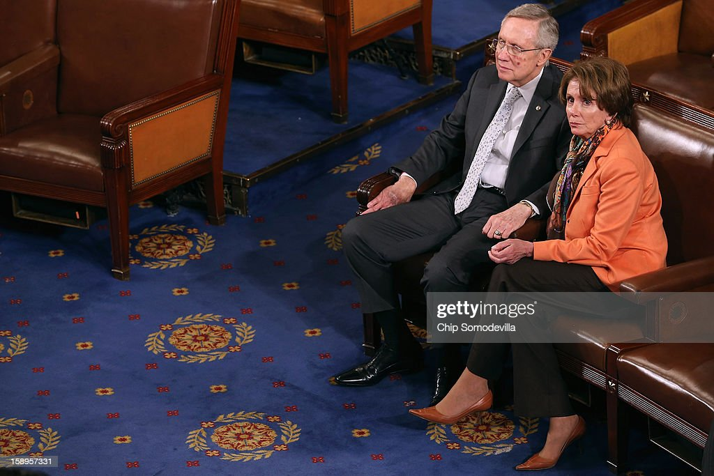 Senate Majority Leader <a gi-track='captionPersonalityLinkClicked' href=/galleries/search?phrase=Harry+Reid+-+Pol%C3%ADtico&family=editorial&specificpeople=203136 ng-click='$event.stopPropagation()'>Harry Reid</a> (D-NV) (L) and House Minority Leader <a gi-track='captionPersonalityLinkClicked' href=/galleries/search?phrase=Nancy+Pelosi&family=editorial&specificpeople=169883 ng-click='$event.stopPropagation()'>Nancy Pelosi</a> (D-CA) talk as the votes of the Electorial College from the 50 states are tallied in the House of Representatives chamber at the U.S. Capitol January 4, 2013 in Washington, DC. The votes were tallied during a joint session of the 113th Congress. President Barack Obama and Vice President Joe Biden received 332 votes to be reelected.
