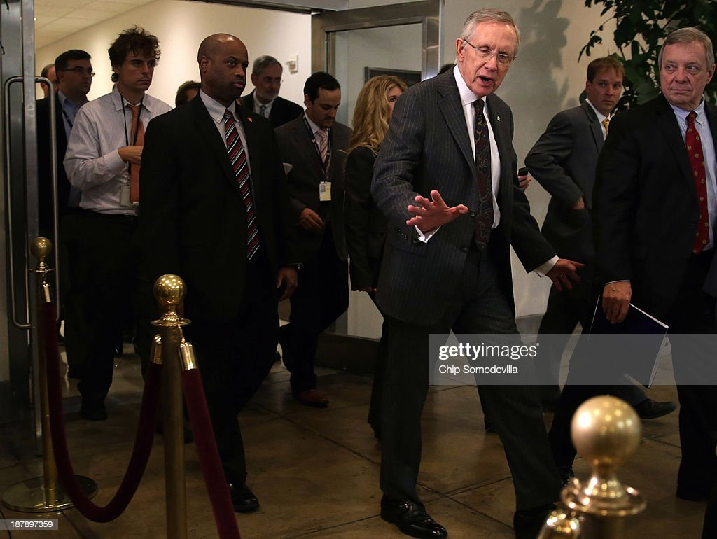 U.S. Senate Majority Leader <a gi-track='captionPersonalityLinkClicked' href=/galleries/search?phrase=Harry+Reid+-+Politician&family=editorial&specificpeople=203136 ng-click='$event.stopPropagation()'>Harry Reid</a> (D-NV) (3rd R) and Majority Whip Richard Durbin (D-IL) (R) leave a closed-door briefing by Secretary of State John Kerry and Vice President Joe Biden at the U.S. Capitol November 13, 2013 in Washington, DC. Kerry is asking Congress not to approve any new sanctions on Iran while negotiations continue with Tehran about its nuclear program.