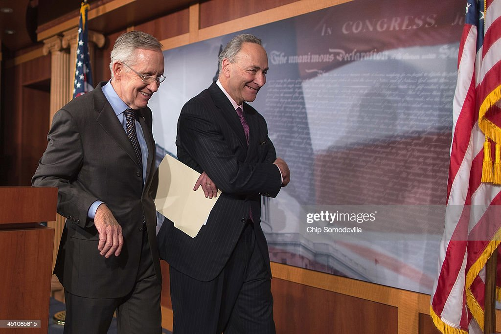 Senate Majority Leader <a gi-track='captionPersonalityLinkClicked' href=/galleries/search?phrase=Harry+Reid+-+Politician&family=editorial&specificpeople=203136 ng-click='$event.stopPropagation()'>Harry Reid</a> (D-NV) (L) and Sen. Chuck Schumer (D-NY) leave after talking to reporters about the use of the 'nuclear option' at the U.S. Capitol November 21, 2013 in Washington, DC. The Senate voted 52-48 to invoke the so-called 'nuclear option', voting to change Senate rules on the controversial filibuster for most presidential nominations with a simple majority vote.